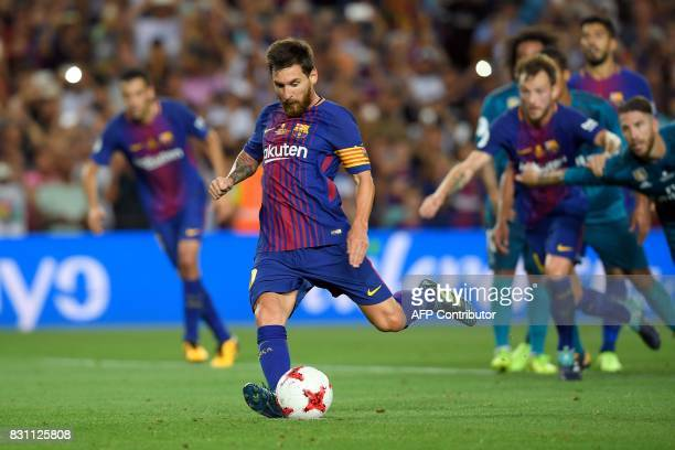 Barcelona's Argentinian forward Lionel Messi kicks a penalty shoot to score a goal during the Spanish Supercup first leg football match FC Barcelona...