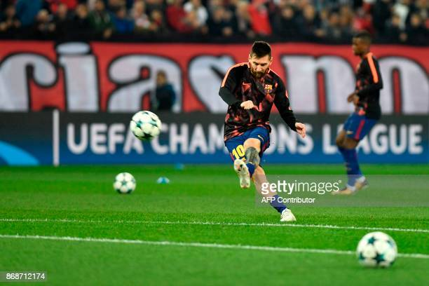 Barcelona's Argentinian forward Lionel Messi kicks the ball as he warms up prior to the UEFA Champions League group D football match between FC...