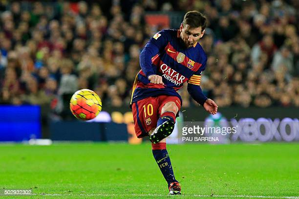 Barcelona's Argentinian forward Lionel Messi kicks the ball during the Spanish league football match FC Barcelona vs Real Betis Balompie at the Camp...