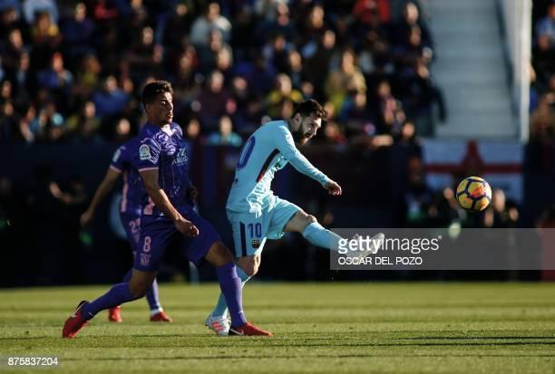 Barcelona's Argentinian forward Lionel Messi kicks the ball past Leganes' Brazilian midfielder Gabriel Appelt during the Spanish league football...