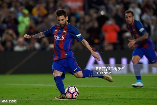Barcelona's Argentinian forward Lionel Messi kicks to score a penaltyduring the Spanish league football match FC Barcelona vs SD Eibar at the Camp...