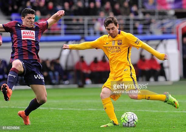 Barcelona's Argentinian forward Lionel Messi kicks to score during the Spanish league football match SD Eibar vs FC Barcelona at the Ipurua stadium...