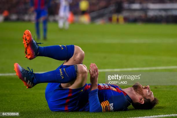 Barcelona's Argentinian forward Lionel Messi lies on the field after missing an opportunity to score during the Spanish league football match FC...