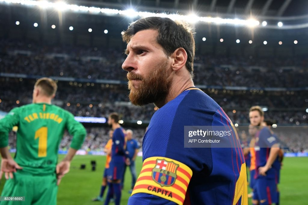 Barcelona's Argentinian forward Lionel Messi looks on after being defeated by Real Madrid at the end of the second leg of the Spanish Supercup football match Real Madrid vs FC Barcelona at the Santiago Bernabeu stadium in Madrid, on August 16, 2017. /