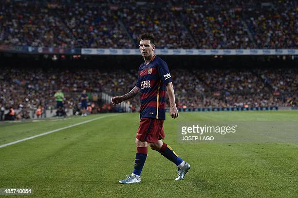 Barcelona's Argentinian forward Lionel Messi looks on as he walks on the pitch during the Spanish league football match FC Barcelona vs Malaga CF at...