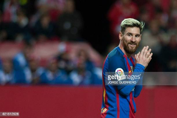 TOPSHOT Barcelona's Argentinian forward Lionel Messi looks on during the Spanish league football match Sevilla FC vs FC Barcelona at the Ramon...