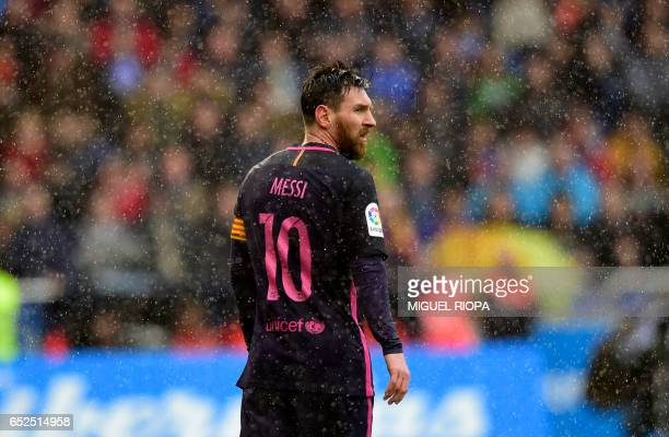 Barcelona's Argentinian forward Lionel Messi looks on during the Spanish league footbal match RC Deportivo de la Coruna vs FC Barcelona at the...