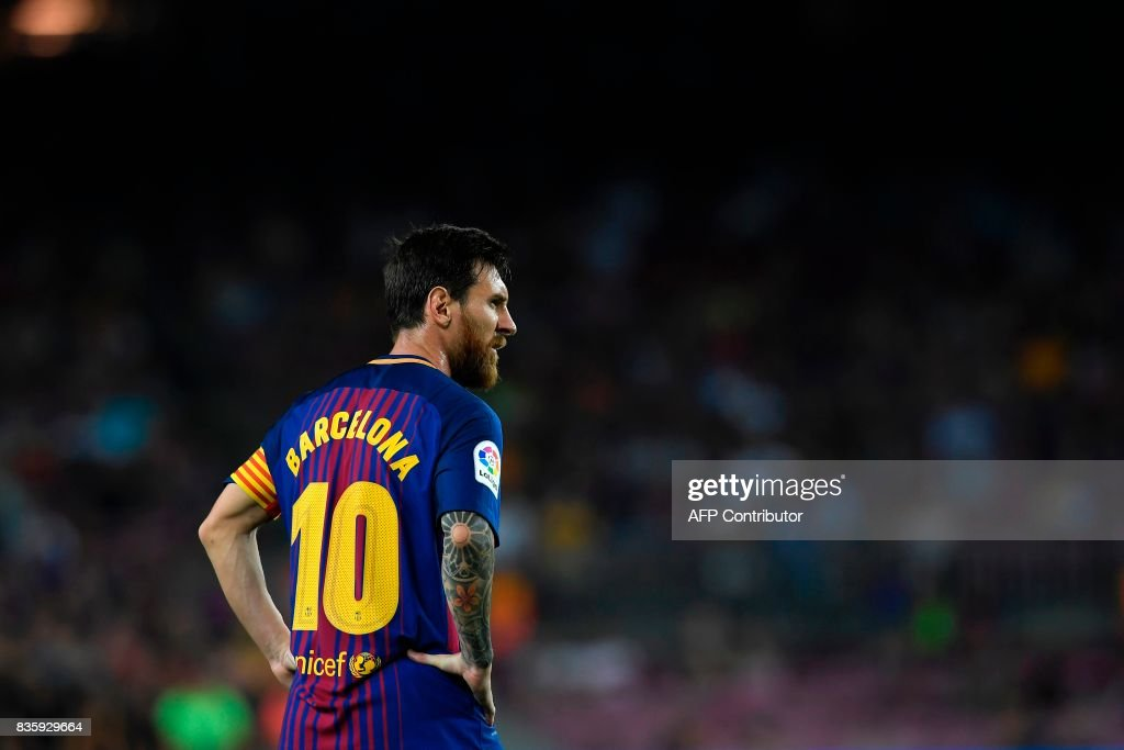 Barcelona's Argentinian forward Lionel Messi looks on during the Spanish league footbal match FC Barcelona vs Real Betis at the Camp Nou stadium in Barcelona on August 20, 2017. /
