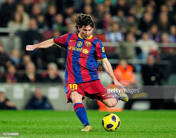 Barcelona's Argentinian forward Lionel Messi plays during the Spanish league football match FC Barcelona vs Real Sociedad on December 12 2010 at Camp...