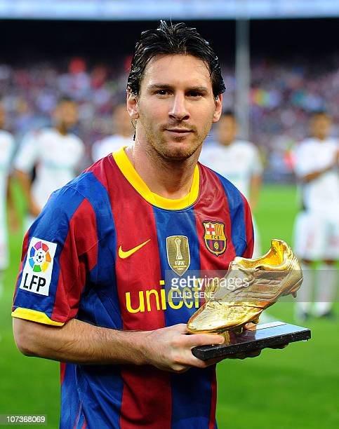 Barcelona's Argentinian forward Lionel Messi poses with his Bota de Oro 2010's trophy awarded as the best European player on October 3 2010 prior to...