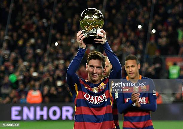 TOPSHOT Barcelona's Argentinian forward Lionel Messi poses with his fifth Ballon d'Or trophy before the Spanish league football match FC Barcelona vs...