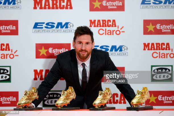 TOPSHOT Barcelona's Argentinian forward Lionel Messi poses with his four Golden Shoe awards after receiving the 2017 European Golden Shoe honoring...
