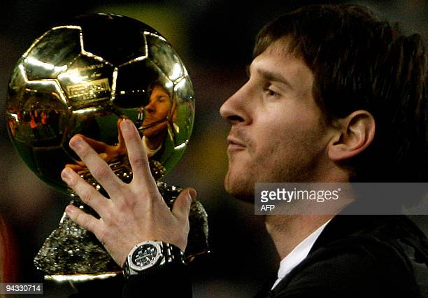 Barcelona's Argentinian forward Lionel Messi poses with his trophy of European footballer of the year award the 'Ballon d'Or' before the Spanish...
