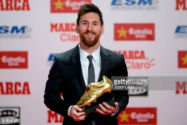 Barcelona's Argentinian forward Lionel Messi poses with the 2017 European Golden Shoe honoring the year's leading goalscorer during a ceremony at the...