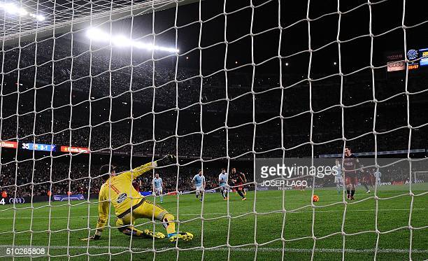 Barcelona's Argentinian forward Lionel Messi prepares to pass the ball to Barcelona's Uruguayan forward Luis Suarez during a penalty kick during the...