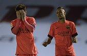 Barcelona's Argentinian forward Lionel Messi reacts after loosing a chance to score a goal next to teammate Brazilian forward Neymar da Silva Santos...