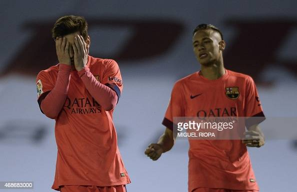 Barcelona's Argentinian forward Lionel Messi reacts after loosing a chance to score a goal next to teammate Brazilian forward Neymar da Silva Santos...