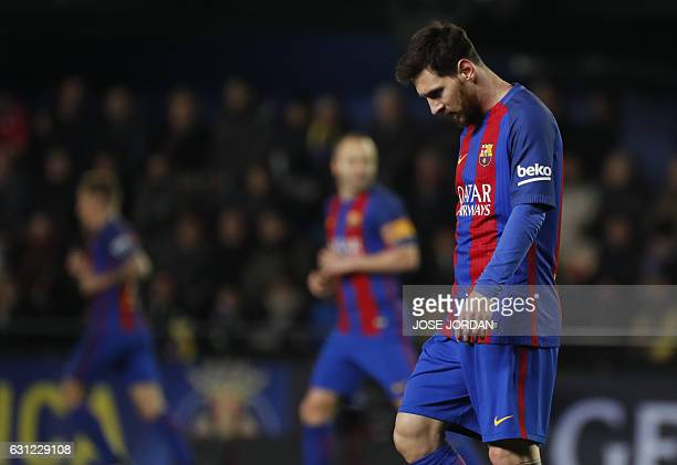 Barcelona's Argentinian forward Lionel Messi reacts after missing an attempt on goal during the Spanish league football match Villarreal CF vs FC...