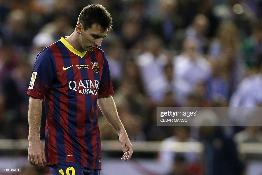 Barcelona's Argentinian forward Lionel Messi reacts at the end of the Spanish Copa del Rey (King's Cup) final 'Clasico' football match FC Barcelona vs Real Madrid CF at the Mestalla stadium in Valencia on April 16, 2014. Real Madrid won the match 2-1.