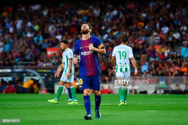 Barcelona's Argentinian forward Lionel Messi reacts during the Spanish league footbal match FC Barcelona vs Real Betis at the Camp Nou stadium in...