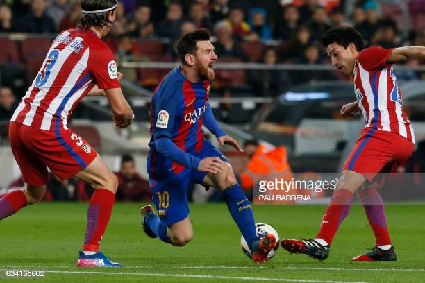 Barcelona's Argentinian forward Lionel Messi reacts past Atletico Madrid's Argentine midfielder Nicolas Gaitan during the Spanish Copa del Rey semi...