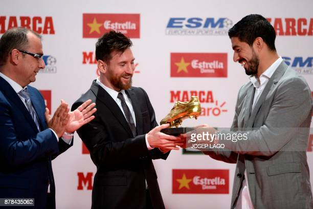 Barcelona's Argentinian forward Lionel Messi receives the 2017 European Golden Shoe honoring the year's leading goalscorer from his teammate...