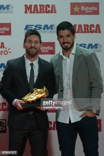 Barcelona's Argentinian forward Lionel Messi receives the 2017 European Golden Shoe honouring the year's leading goalscorer from his teammate...