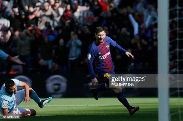 Barcelona's Argentinian forward Lionel Messi runs after scoring the equalizer goal during the Spanish league football match FC Barcelona vs RC Celta...