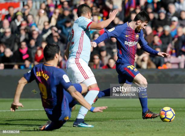Barcelona's Argentinian forward Lionel Messi runs to shoot and score the equalizer goal during the Spanish league football match FC Barcelona vs RC...