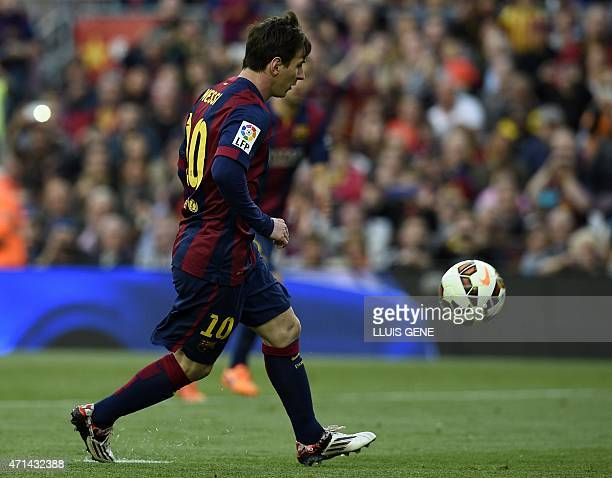 Barcelona's Argentinian forward Lionel Messi scores a goal during the Spanish league football match FC Barcelona vs Getafe at the Camp Nou stadium in...
