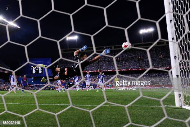 Barcelona's Argentinian forward Lionel Messi scores against Deportivo Alaves' goalkeeper Fernando Pacheco during the Spanish Copa del Rey final...