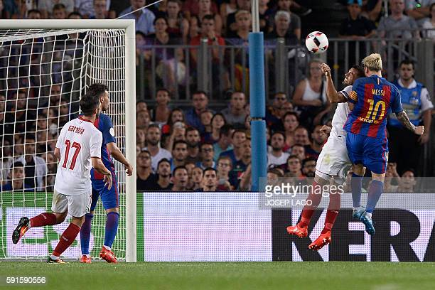 Barcelona's Argentinian forward Lionel Messi scores during the second leg of the Spanish Supercup football match between FC Barcelona and Sevilla FC...
