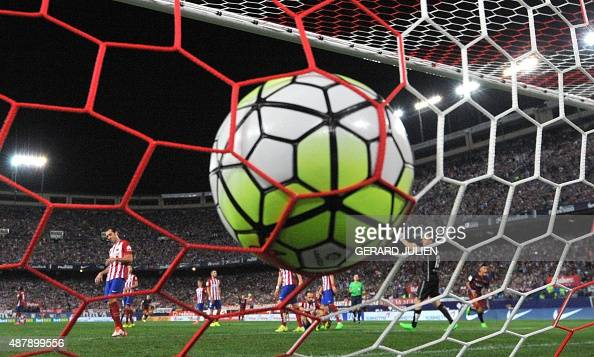 Barcelona's Argentinian forward Lionel Messi scores during the Spanish league football match Club Atletico de Madrid vs FC Barcelona at the Vicente...