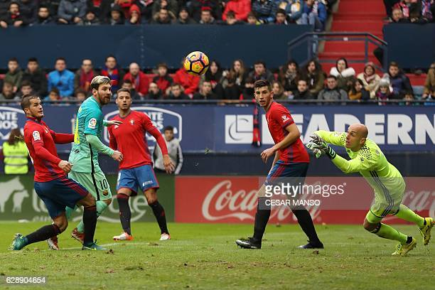 Barcelona's Argentinian forward Lionel Messi scores during the Spanish league football match CA Osasuna vs FC Barcelona at the Reyno de Navarra...