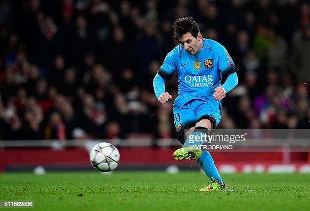 Barcelona's Argentinian forward Lionel Messi scores his team's second goal from the penalty spot during the UEFA Champions League round of 16 1st leg...