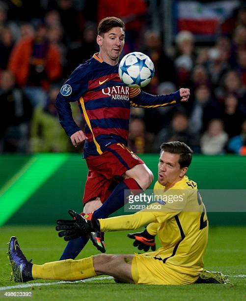 Barcelona's Argentinian forward Lionel Messi scores past Roma's Polish goalkeeper Wojciech Szczesny during the UEFA Champions League Group E football...
