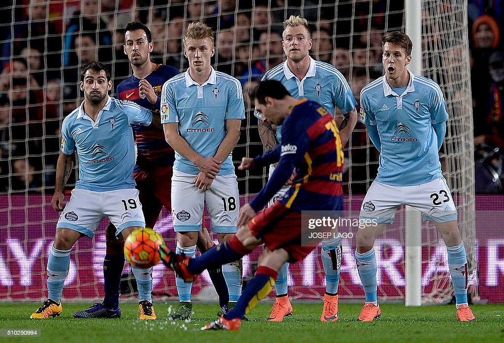 Barcelona's Argentinian forward Lionel Messi shoots a free kick to score a goal during the Spanish league football match FC Barcelona vs RC Celta de Vigo at the Camp Nou stadium in Barcelona on February 14, 2016. LAGO