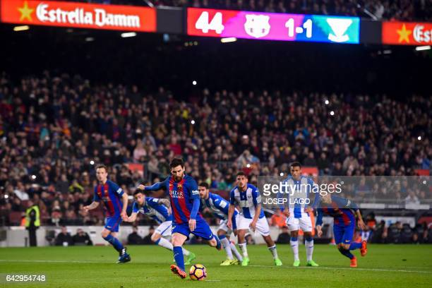 Barcelona's Argentinian forward Lionel Messi shoots a penalty kick to score a goal during the Spanish league football match FC Barcelona vs CD...