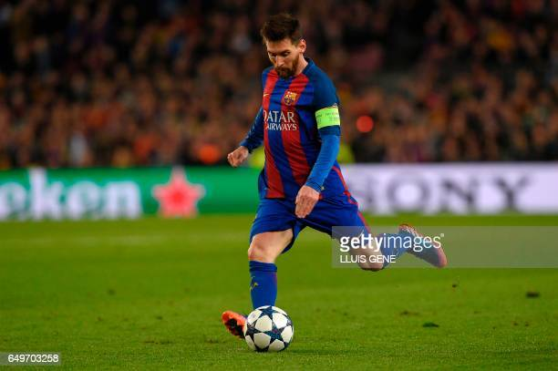 Barcelona's Argentinian forward Lionel Messi shoots a penalty kick to score a goal during the UEFA Champions League round of 16 second leg football...