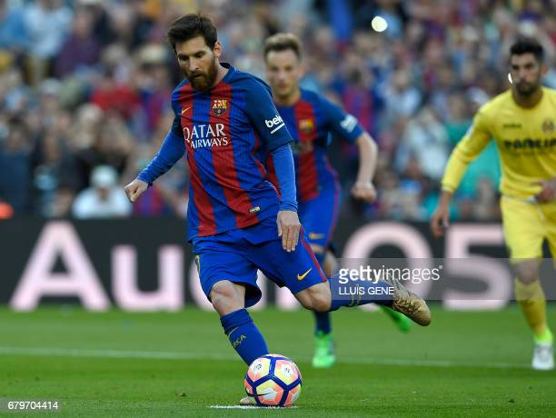 Barcelona's Argentinian forward Lionel Messi shoots a penalty kick to score a goal during the Spanish league football match FC Barcelona vs...