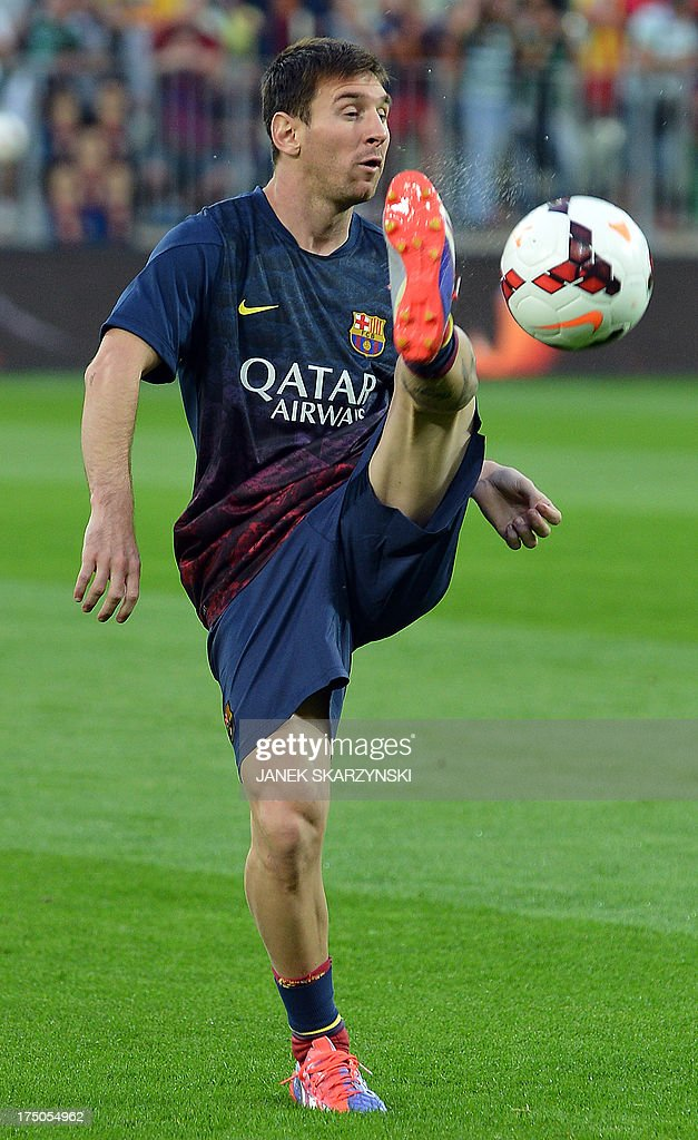 Barcelona's Argentinian forward <a gi-track='captionPersonalityLinkClicked' href=/galleries/search?phrase=Lionel+Messi&family=editorial&specificpeople=453305 ng-click='$event.stopPropagation()'>Lionel Messi</a> shoots during a warm-up before their preseason friendly football match Lechia Gdansk vs FC Barcelona at the PGE Arena in Gdansk, on July 30, 2013. SKARZYNSKI