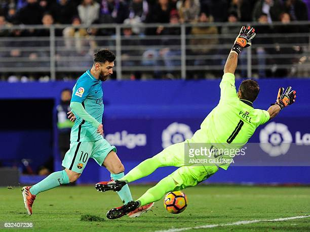 Barcelona's Argentinian forward Lionel Messi shoots to score during the Spanish league football match SD Eibar vs FC Barcelona at the Ipurua stadium...