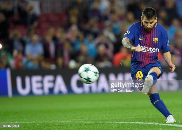 Barcelona's Argentinian forward Lionel Messi shoots to score his goal number 100 in a European competition during the UEFA Champions League group D...