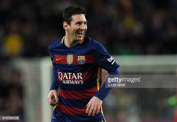 Barcelona's Argentinian forward Lionel Messi smiles after scoring a goal during the Spanish league football match FC Barcelona vs RC Celta de Vigo at...