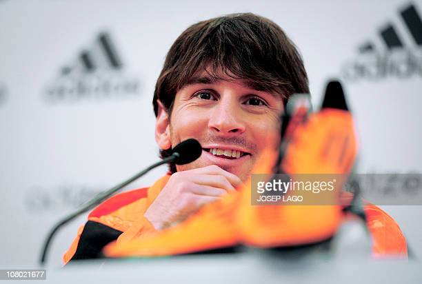 Barcelona's Argentinian forward Lionel Messi smiles during the presentation of his new boots in a sports shop on January 13 2011 in Barcelona AFP...
