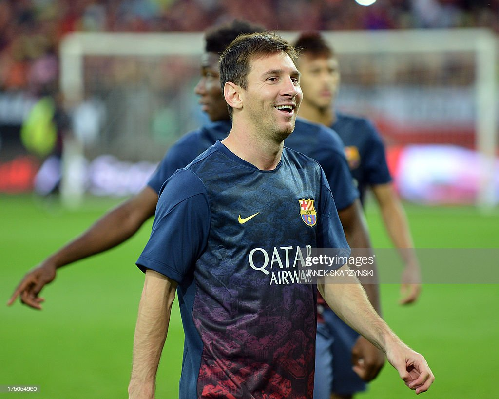 Barcelona's Argentinian forward <a gi-track='captionPersonalityLinkClicked' href=/galleries/search?phrase=Lionel+Messi&family=editorial&specificpeople=453305 ng-click='$event.stopPropagation()'>Lionel Messi</a> stands by teammates on the pitch before their preseason friendly football match Lechia Gdansk vs FC Barcelona at the PGE Arena in Gdansk, on July 30, 2013. SKARZYNSKI