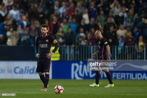 Barcelona's Argentinian forward Lionel Messi stands during the Spanish league football match Malaga CF vs FC Barcelona at La Rosaleda stadium in...