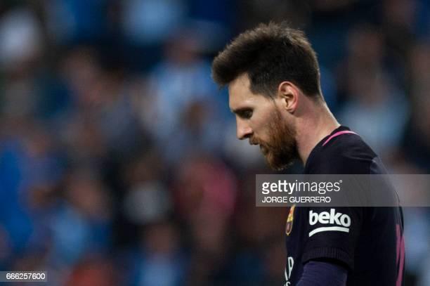 TOPSHOT Barcelona's Argentinian forward Lionel Messi stands during the Spanish league football match Malaga CF vs FC Barcelona at La Rosaleda stadium...