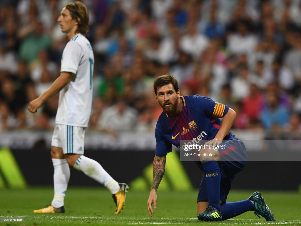 Barcelona's Argentinian forward Lionel Messi stands up after falling during the second leg of the Spanish Supercup football match Real Madrid vs FC Barcelona at the Santiago Bernabeu stadium in Madrid, on August 16, 2017. /