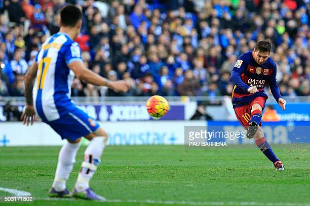 Barcelona's Argentinian forward Lionel Messi takes a free kick during the Spanish league football match RCD Espanyol vs FC Barcelona atthe Power8...